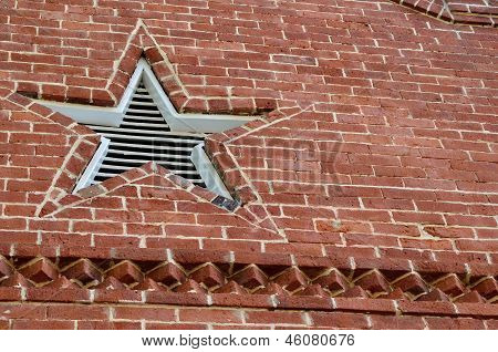 Star vent in brick building