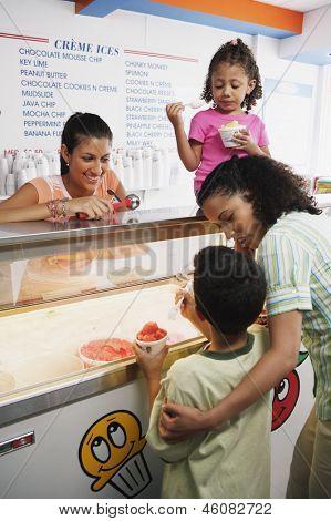Family getting ice cream in ice cream shop