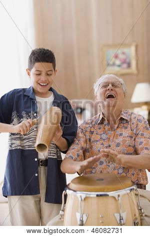 Grandfather and grandson playing percussion instruments