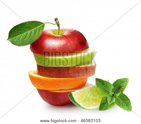 Apples and orange fruit with lime and green mint leaves isolated.