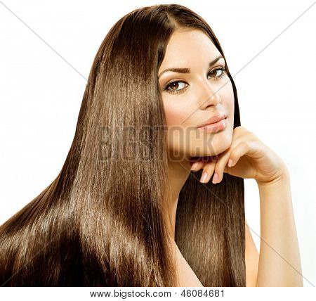 Long Straight Hair. Beautiful Brunette Girl isolated on white background. Smooth and Shiny Brown Hair. Beauty Model Woman. Healthy Skin, Hair and Nails