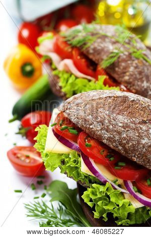 Grain bread sandwiches with ham,cheese and fresh vegetables over white - healthy eating concept