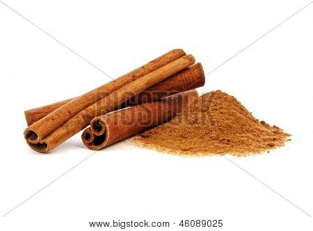 Cinnamon sticks and powder on white background