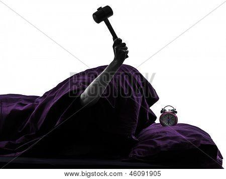 one person smashing alarm clock in bed waking up smashing alarm clock silhouette studio on white background