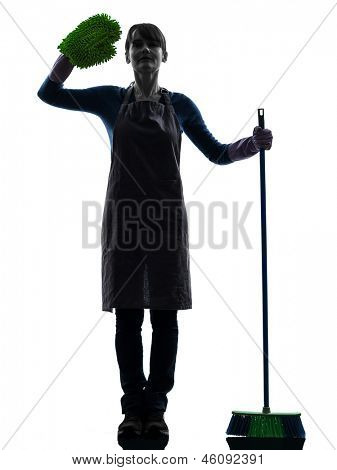one caucasian woman maid saluting brooming   in silhouette studio isolated on white background