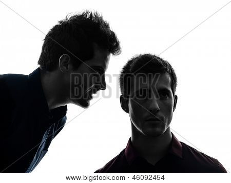 two caucasian young men hearing voices influencing in shadow  white background