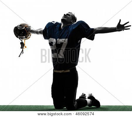 one caucasian american football player man triumphant in silhouette studio isolated on white background