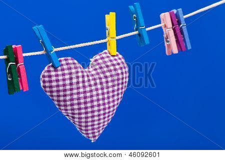 Single Heart On Clothesline With Clothespins, Blue Background