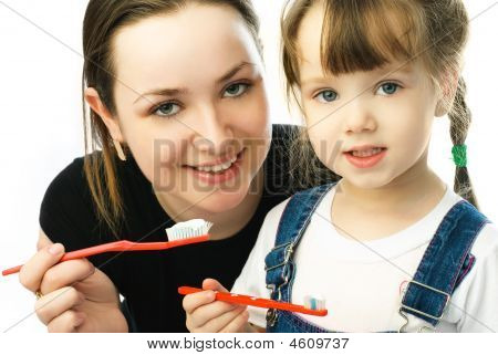 Mother Teaching Her Daughter Brushing Teeth