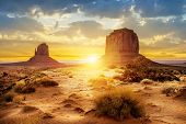 stock photo of rocking  - Sunset at the sisters in Monument Valley USA - JPG
