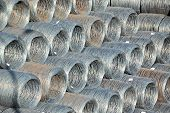 stock photo of ironworker  - Stacked steel wire roll ready for shipment in port - JPG