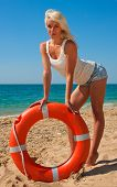 foto of lifeline  - Beautiful slim girl on the beach with a lifeline - JPG