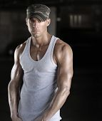 stock photo of arm muscle  - Muscular young sexy soldier man in camo army cap - JPG