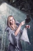 stock photo of raven  - Beautiful Cute Young Blonde Lady With Raven - JPG