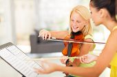 stock photo of pre-teens  - beautiful preteen girl in music class with music teacher - JPG