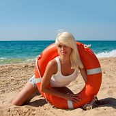 image of lifeline  - Beautiful slim girl on the beach with a lifeline - JPG