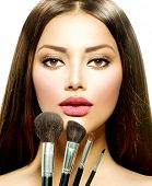 stock photo of makeover  - Beauty Girl with Makeup Brushes - JPG