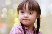 foto of playgroup  - Portrait of happy young girl in the park - JPG