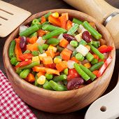 stock photo of lenten  - mixed vegetables in wooden bowl on kitchen table - JPG