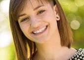 image of facial piercings  - Portrait Of Happy Woman - JPG