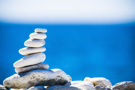 picture of stability  - Stones balance hierarchy stack over blue sea in Croatia - JPG