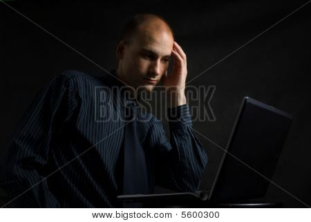 Businessman Working On Computer Late At Night