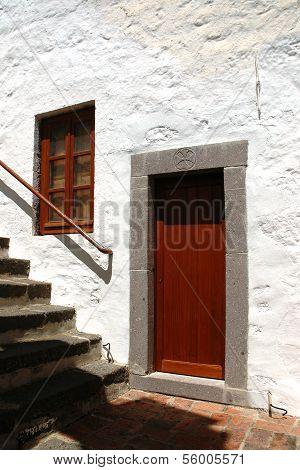 ISLAND PATMOS, GREEK CIRCA JUNE 2005 - Brown door in a stone door frame