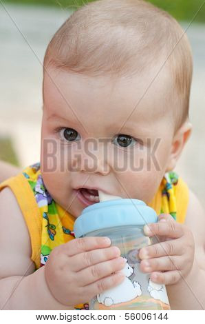Six Months Baby Drinking From Bottle