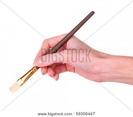 Hand holding brush isolated on white