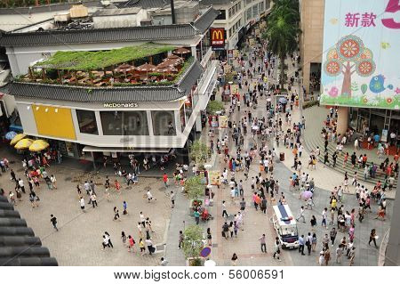 SHENZHEN, CHINA-MAY 27: Shoppers and visitors crowd the famous Dongmen Pedestrian Street on May 27, 2012 in Shenzhen, China. This city is regarded as one of the most successful Special Economic Zones.