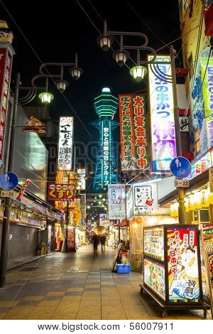 OSAKA, JAPAN - DEC 2: Tsutenkaku Tower in Shinsekai (new world) district at night. Tsutenkaku tower and the area are developed in 1912 with New York and Paris as models. Taken on December 2 2013.
