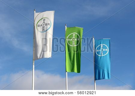 Bayer Flags Against Blue Sky