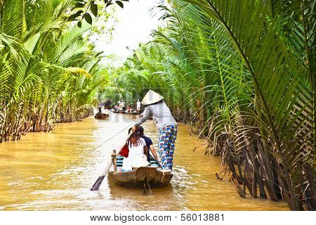 A famous tourist destination is  Ben Tre village in Mekong delta , Vietnam. Mekong Delta is home of people who live along the many channels.