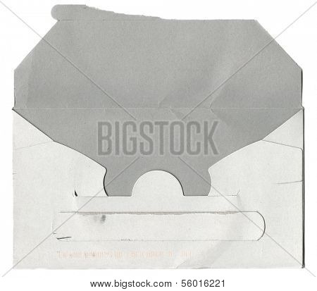 Opened and damaged cardboard envelope on white background