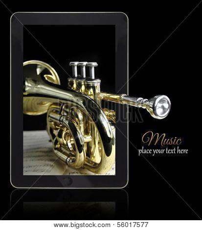 Online music with golden trumpet on black with copy-space