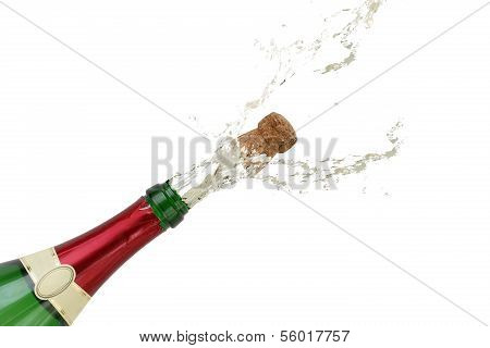 Champagne Splashing Out Of The Bottle On New Year's Eve Or Party