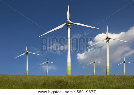 Wind Turbines On A Meadow Green Energy