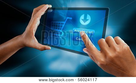 a woman finger make shopping online on a digital screen