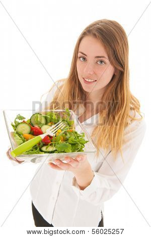 Woman holding fresh salad in glass bowl for diet - focal point on salad