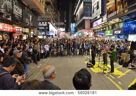 Street performers draw a big crowd to see them perform in Mongkok