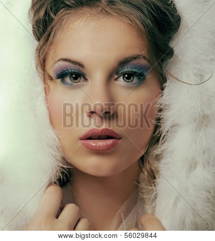 beautiful model with makeup and fir, winter topic, closeup