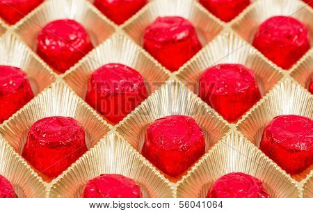 Wrapped chocolate in red Christmas decoration