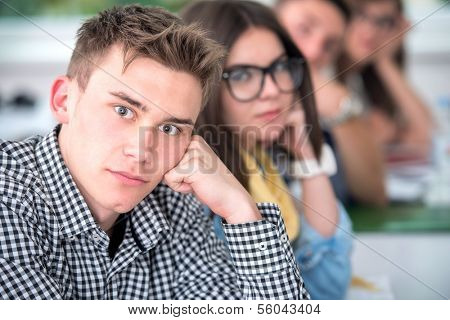 Portrait of a highschool boy posing in classroom