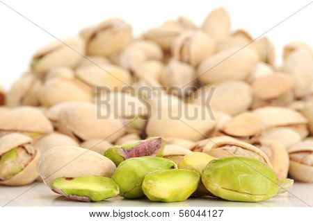 Extreme close-up image of pistachios with pistachios in background