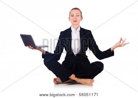 Businesswoman meditating isolated on white