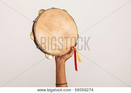 Hand Holding Tamburin