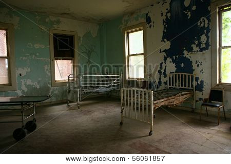 Abandoned Hospital Building With Empty Rusted Beds