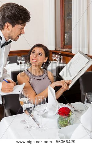 Young Smiling Couple At The Restaurant