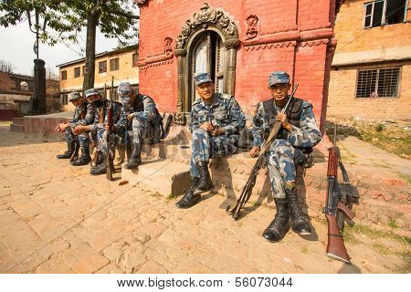 KATHMANDU, NEPAL - DEC 19: Unknown nepalese soldiers Armed Police Force near public school, Dec 19, 2013 in Kathmandu, Nepal. Initially founded with a roster of 15,000 police and military personnel.