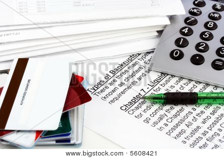 Bankruptcy Document With Bills, Credit Cards, Calculator And Pen.  Copy Space On One Blank Credit Ca